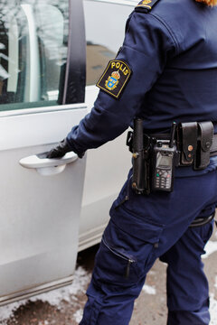 Police woman opening car, Sweden