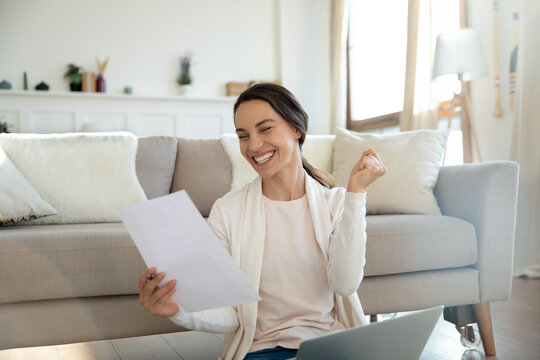 Yes. Overjoyed young woman remote employee reading paper letter from company informing she is hired on vacant place, happy millennial lady bank client getting loan mortgage credit application approval