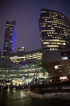 Warsaw, Poland - 19 January 2018. Zlote Tarasy shoppinh center. Warsaw business center at night. Winter, everything is covered by snow.
