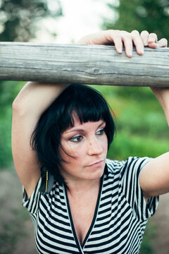 Dark-haired woman outdoors in the village.