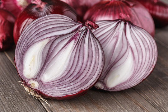 red onions on rustic wood