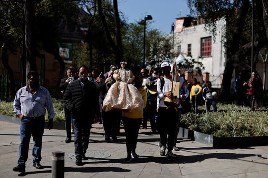 Mariachis play their instruments as they pay homage to Saint Cecilia, the patron saint of musicians, during the annual pilgrimage as the coronavirus disease (COVID-19) outbreak continues, in Mexico City