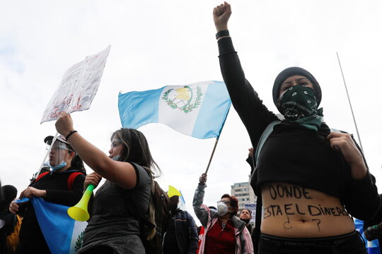 Demonstrators shout slogans during a protest to demand the resignation of President Alejandro Giammattei, a day after protesters set fire to a part of the Congress building in Guatemala City