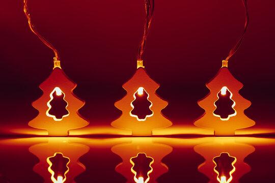 Christmas tree shape garland, illuminated glow light at night