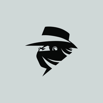 Cowboy masked outlaw side view portrait symbol on gray backdrop. Design element