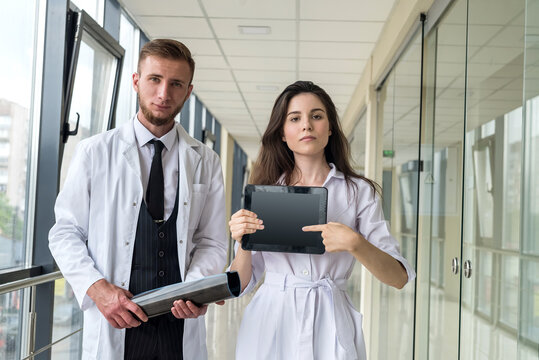 Beautiful young doctors are looking at camera in clinic