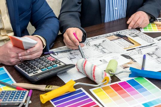 interior designer work with apartament sketch, color palette, laptop at office desk
