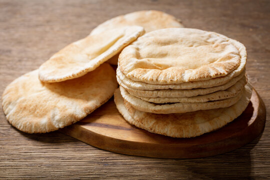 fresh pita bread on a wooden table
