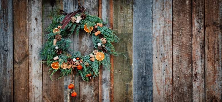 Green Christmas Wreath on Wooden Background