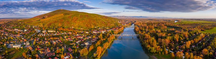Tokaj, Hungary - Ultra wide aerial panoramic view of the small town of Tokaj with golden vineyards...