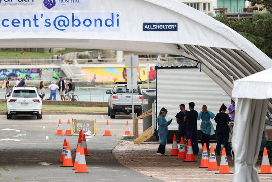 Medical workers are seen at a COVID-19 testing centre at Bondi Beach in Sydney