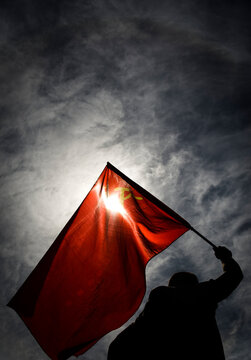 Low Angle View Of Soviet Flag Against Sky At Night