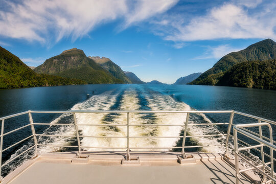 Spectacular alpine and water panoramic views on a cruise in the wilderness of the fjord at Doubtful Sound in New Zealand, South Island.