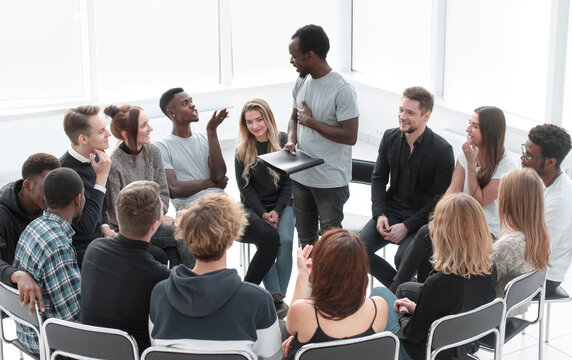business coach conducts a seminar for a group of young people