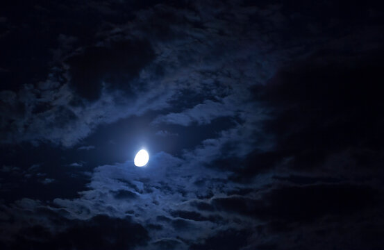 Full Moon on Dramatic Clouds and Sky