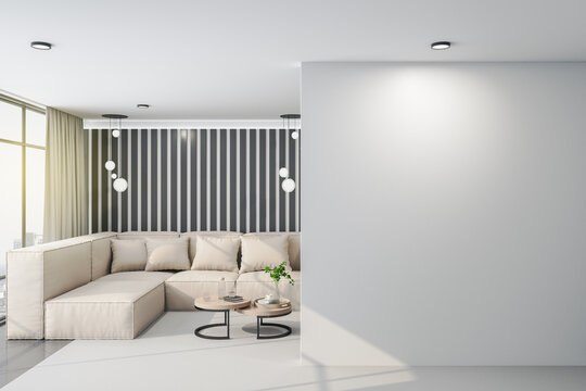Luxury living room with sofa and blank gray wall.