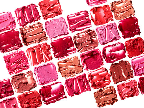 Different colors lipstick smudges isolated on white background