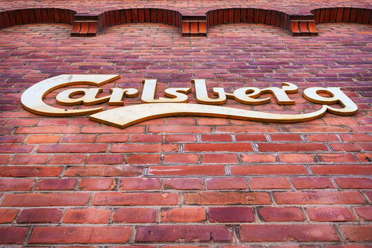 Copenhagen. Denmark. July 25, 2019. Carlsberg Brewery logo on a brick wall. Bottom View Attractions.