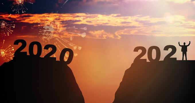 Silhouette hill and coronavirus covid19 2020 and 2021 years with sunset sky background.Fight Covid19 pandemic year with hope.Happy new year 2021. Vaccine Success.New normal New year.banner background.