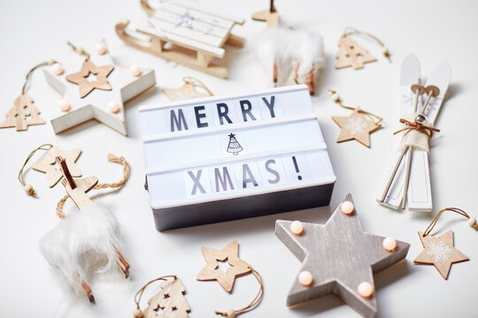 Light box inscription Merry Xmas and wooden ornaments