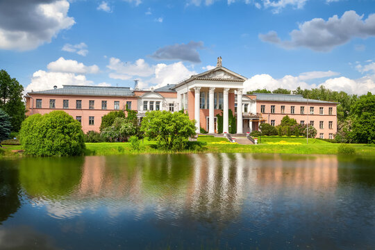 Main Botanical Garden Of The Moscow. Classical building with columns reflecting in Botanical Pond