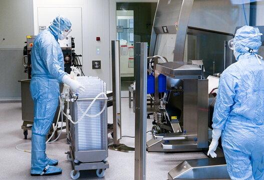 Staff works at the vaccine maker IDT Biologika production in Dessau Rosslau