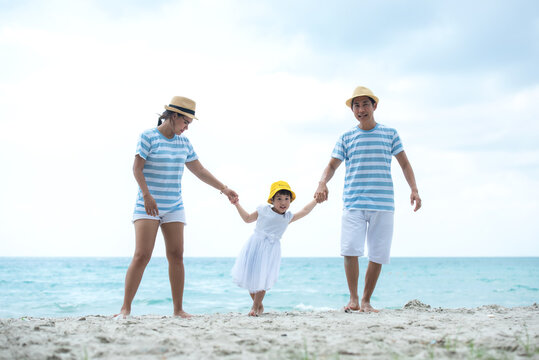Happy family summer sea beach vacation. Asia youngpeople lifestyle travel enjoy fun and relax leisure destination in holiday.