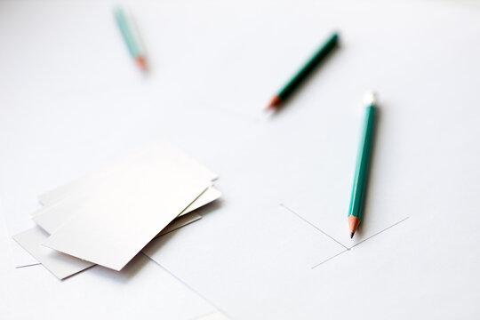 beginning drawing on a sheet of white paper and blank business cards