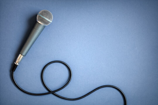 Microphone background on blue concept for blog, jpodcast, journalist or musician