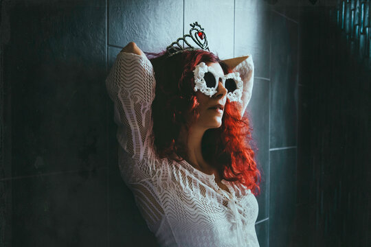 Woman Wearing Novelty Glasses While Leaning On Wall