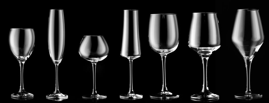 Different empty glasses on dark background