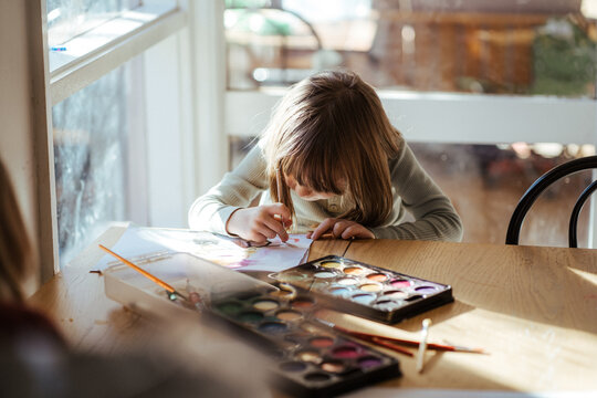Girl painting with watercolour