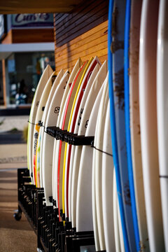 Surfboards lined up outside a surf shop