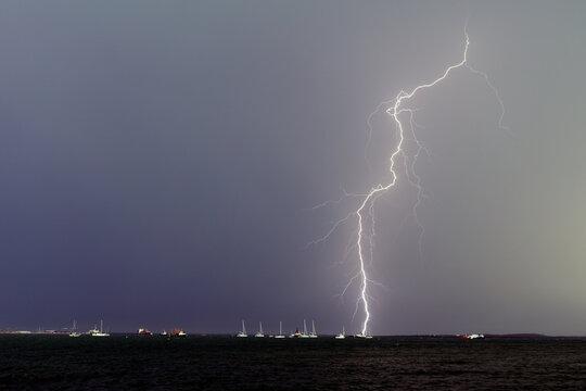 Lightning bolt over yachts in Darwin