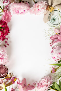 Cultery, glasses and flowers - Spring and festive table setting concept