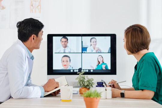 Doctors having online conference with colleagues from other hospitals, discussing newest medicine and methods of diagnostics