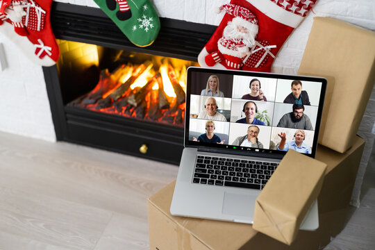 Christmas day Virtual meeting team teleworking. Family video call remote conference. Laptop webcam screen view. Diverse portrait headshots meet working from their home offices. Happy hour party online