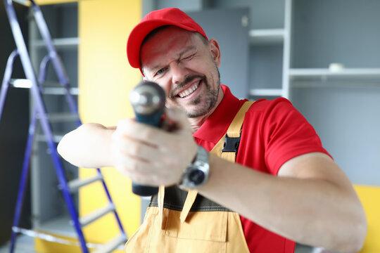 Happy professional repairman at work