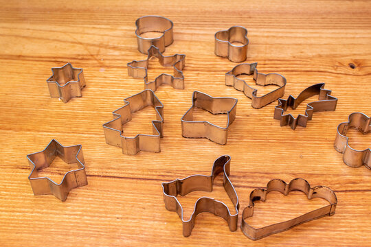 Gingerbread aluminum cookie cutters on wooden board