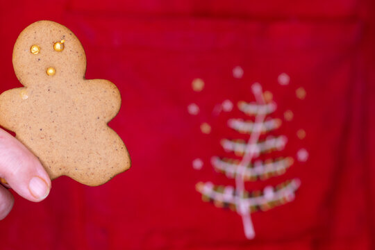 Gingerbread lady cookie on red Christmas background