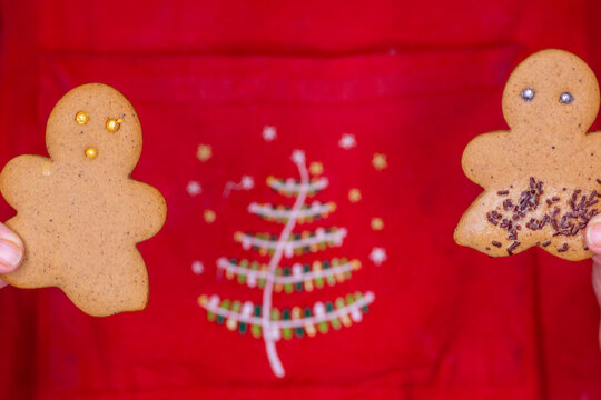 Gingerbread Man cookie on red Christmas background