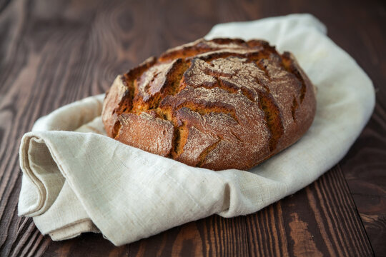 rye circle bread in a linen cloth