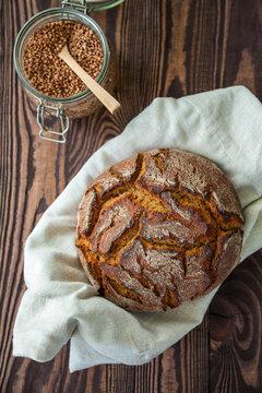 Circle buckwheat flour bread on a linen cloth