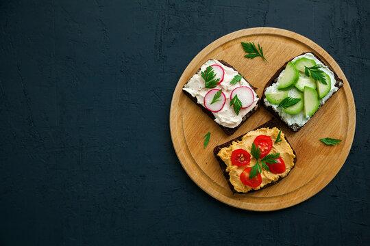 Top view vegetarian rye bread toasts