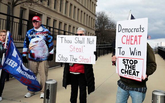 U.S. President Donald Trump's supporters  protest as the Board of State Canvassers meet to certify the results of the election in Lansing