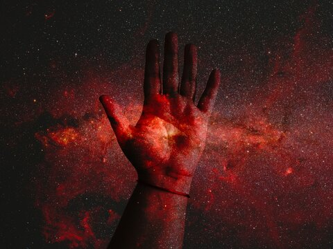 Digital Composite Image Of Hand And Galaxy