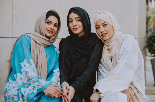 Three women friends going out in Dubai. Girls wearing the united arab emirates traditional abaya