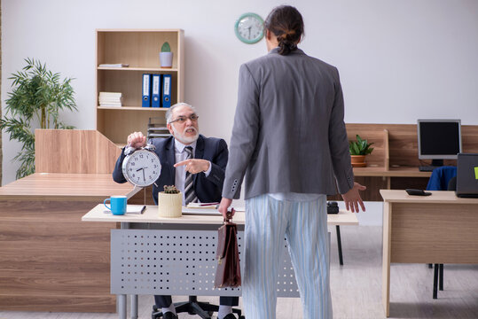Young male employee being late for work