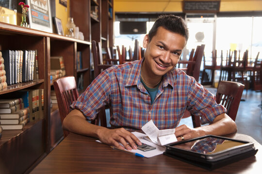 Malaysian business owner working in cafe
