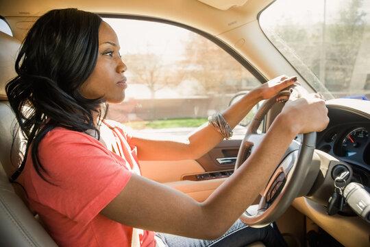 African American woman driving car